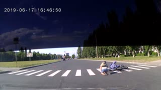 Cyclists Collide While Crossing a Russian Road