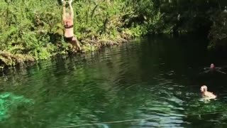 Collab copyright protection - black swim suit blonde zipline water - Video
