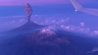 Stunning footage of Popocatépetl Volcano erupting from airplane window