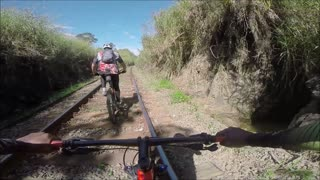 Cyclists Narrowly Avoid Oncoming Train