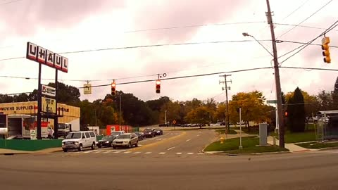 Dash cam footage captures oblivious driver's near miss