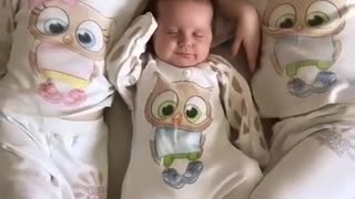 Twins sleeping Next To Their Baby Brother Like Little Gangesters