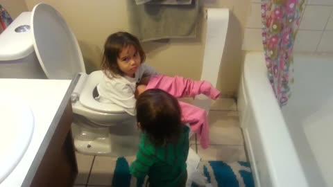 Girl falls in toilet while baby brother makes a mess with toilet paper