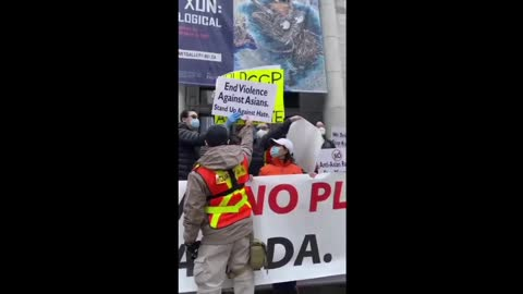 Vancouver, CA - Stop Asian Hate Rally - Security Joins In To Block CCP Sign.