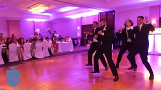 Groomsmen Perform Surprise Wedding Dance For Newlyweds - Video
