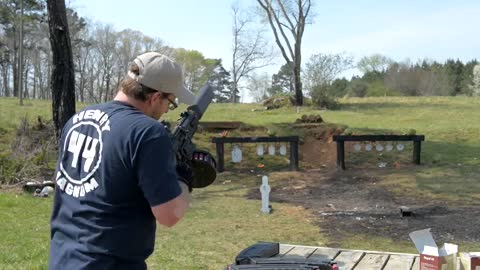 30 shots in 8 seconds with a silenced 12 gauge shotgun