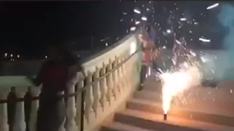 Women in lingerie model in front of fire cracker and run away after it goes off