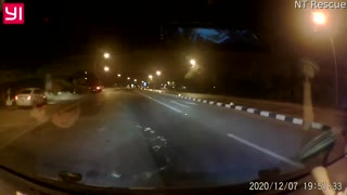 Driver Narrowly Dodges Debris Strewn Across Highway