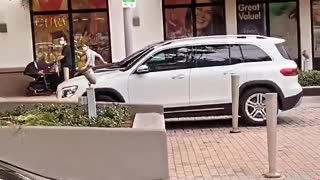 No Hands Driver Crashes into Parked Car