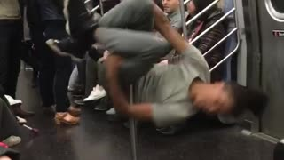 Guy grey dancing spinning subway pole - Video