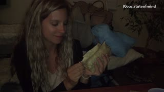 Girl shares burrito with black cat - Video