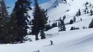 Two guys pink and green skis jump