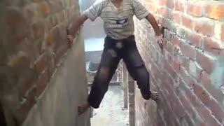 A spider boy climbing the wall  - Video