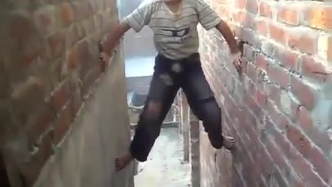 A spider boy climbing the wall