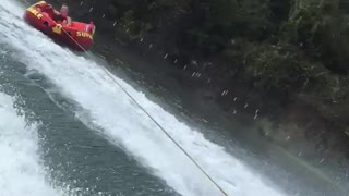 Person on tube wakeboarding flips over - Video