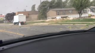 Utah Tornado Sends Debris Flying Across the Road - Video