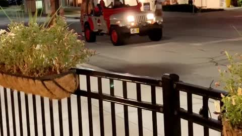 T-Rex's Chase Jeep Through Town