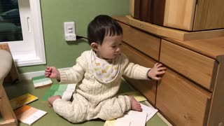 This sweet toddler has a surprise hiding in the drawer