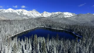 Aerial Flight Over A Wintry Snow Covered Lake