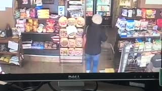 Security camera, woman walks inside convenience store, trips on floor and falls