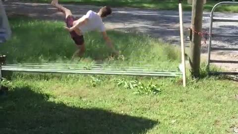 Guy jumps over gate it falls