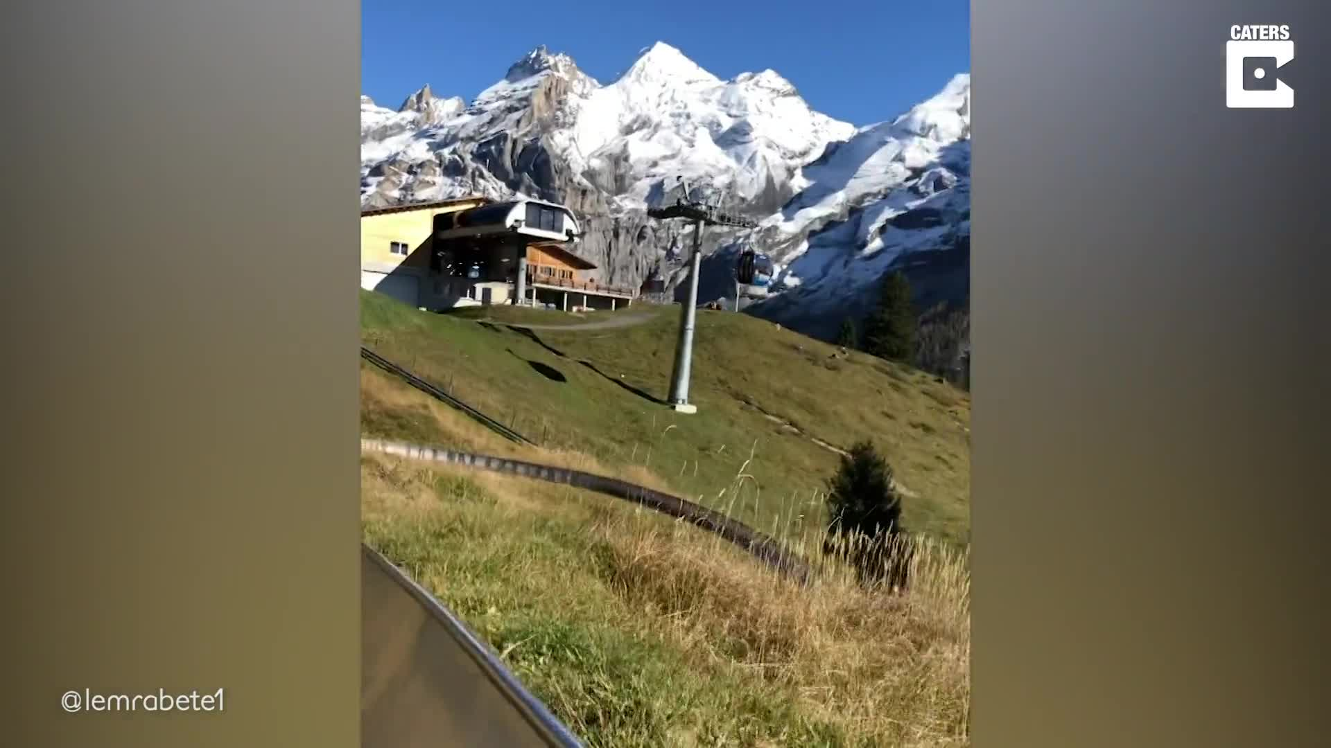 SCENIC SLIDE LETS RIDERS VIEW STUNNING SWISS MOUNTAINS AND LAKE