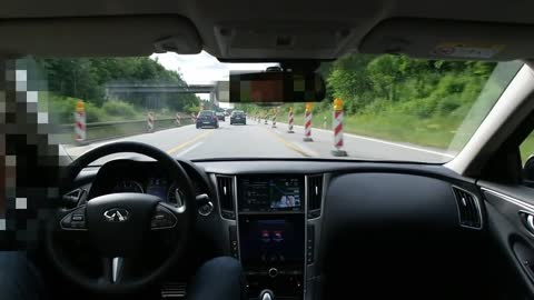 Infiniti Q50 with active lane control drives itself on highway