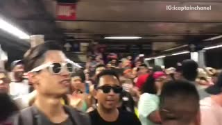 Crowd jumping cheering party underground subway station
