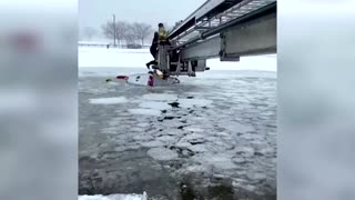 U.S. firefighters rescue civilians from icy river