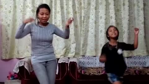 daughter is imitating the dance steps of mom