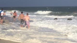 Emergency Team Performs Multiple Person Rescue at Beach - Video