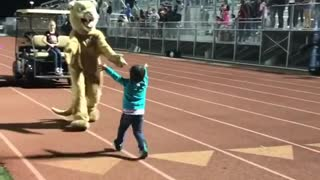 Toddler Shows Off Dance Moves In Front Of A Crowded Stadium - Video