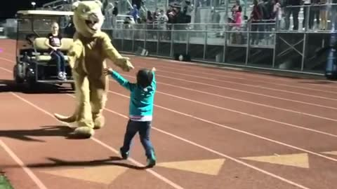 Toddler Shows Off Dance Moves In Front Of A Crowded Stadium