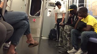 Man in white doing arm exercise on subway  - Video