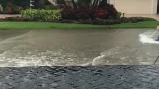 Tropical Storm Kneeboarding in the Streets - Video