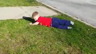 Collab copyright protection - young child red shirt faceplant - Video