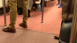 Black helmet man has razor scooter on subway - Video