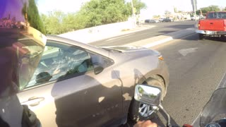 Overtaking Battle Between Motorcycle and Car