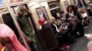 Man and woman dance perform on subway train - Video