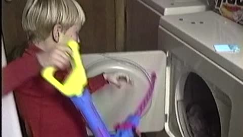 Little sister in the laundry dryer... Wait for it!