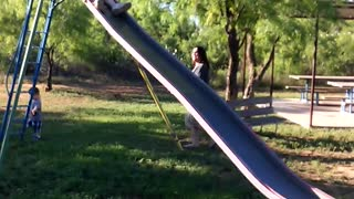 Grandma takes slide too fast, totally wipes out - Video