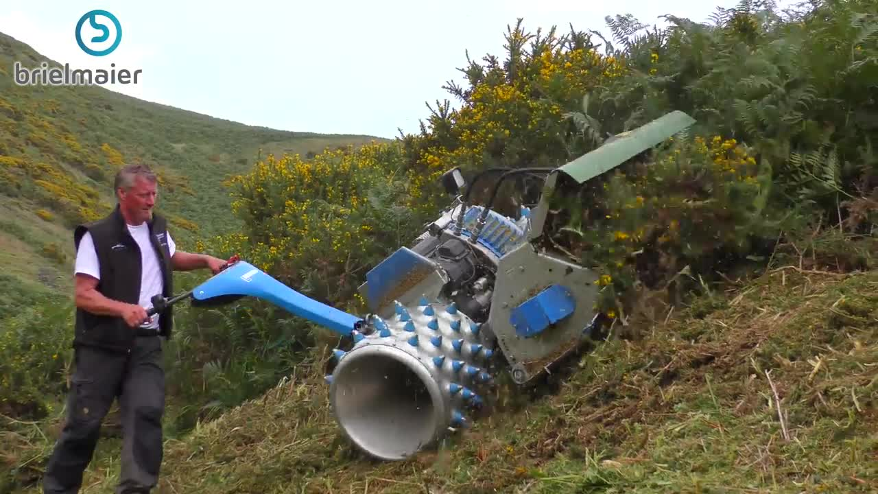Lawn Mower On A Hill : This lawn mower cuts mountainside grass and will blow your