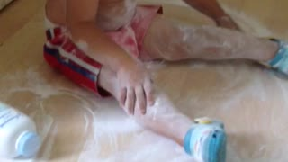 Little one gets caught with baby powder  - Video