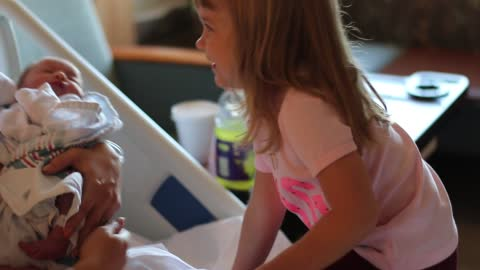 Toddler has sweetest reaction ever to meeting baby sister