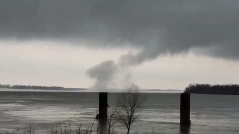 Strange looking tornado forms over the Mississippi River