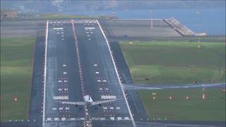 Plane Struggles To Land In High Winds At Notorious Airport - Video