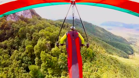POV hang-gliding over stunning Carpathian Mountains
