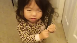 Toddler hysterically gets comb stuck in her hair