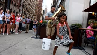 Talented little girl dances along to live jazz performance