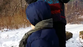 Baby can't make up his mind about sledding - Video
